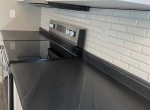 Kithcen counter with classic subway tiled backsplash