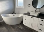 main bathroom with stand alone bathtub